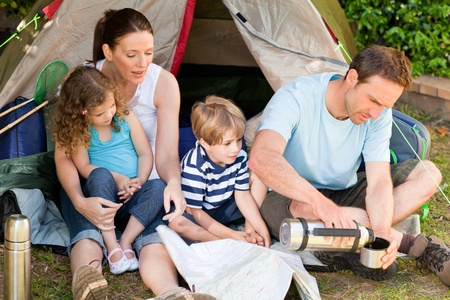 Adorable family camping in the garden Stock Photo - 10174364