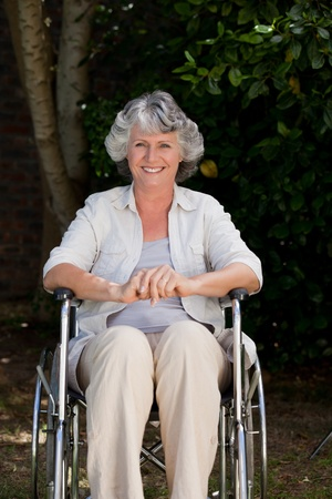 Smiling woman in her wheelchair photo