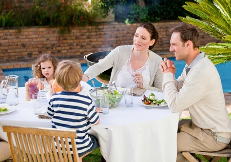 Family eating in the garden photo