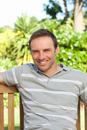 Portrait of a man sitting on a  bench Stock Photo - 10173481