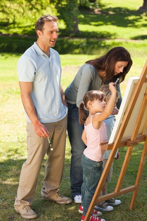 Family painting together in the park Stock Photo - 10220683