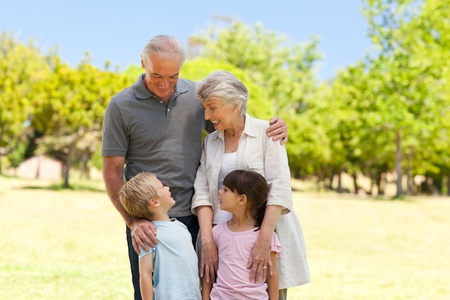 Grandparents with their grandchildren in the park photo