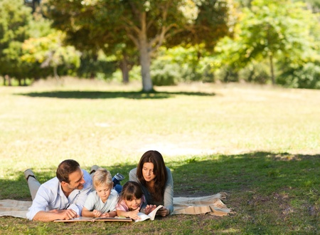 Family in the park together photo