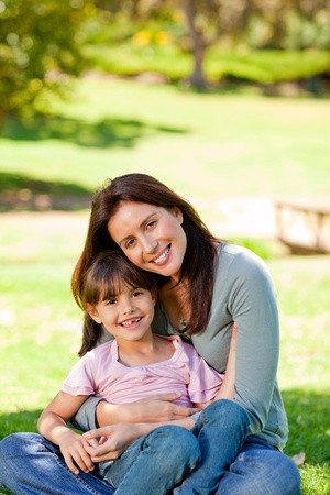 Happy mother with her daughter in the park photo