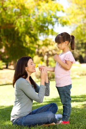 Beautiful mother with her daughter in the park photo