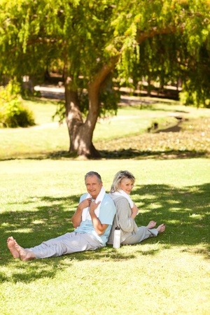 Couple after their streches in the park Stock Photo - 10198446