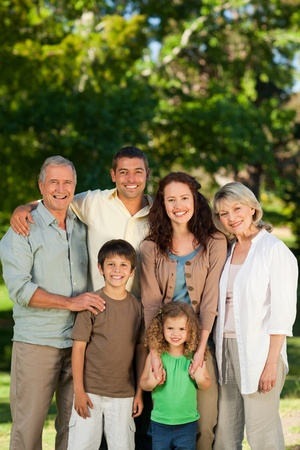 Family looking at the camera in the park Stock Photo - 10173862