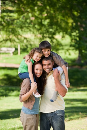 having fun: Parents giving children a piggyback Stock Photo