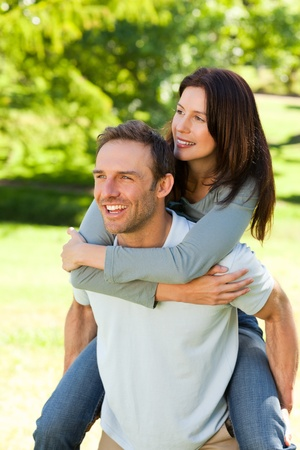 Man giving wife a piggyback photo