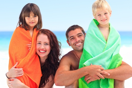 Parents with their children in towels photo