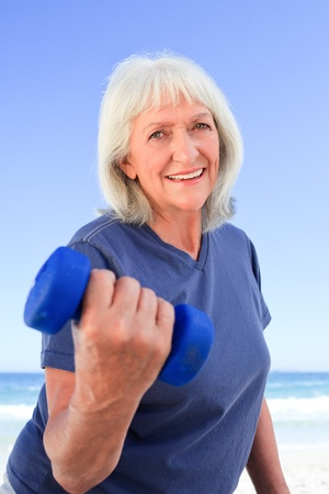 Mature woman doing her exercises photo