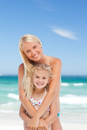 love hot body: Mother embracing her daughter Stock Photo