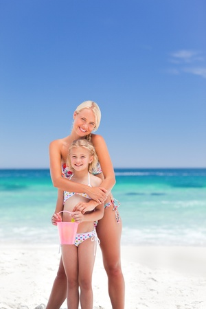 love hot body: Beautiful mother embracing her daughter Stock Photo