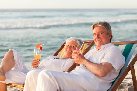 Retired couple drinking a cocktail Stock Photo - 10171562