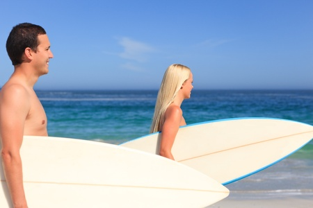 Couple with their surfboards photo