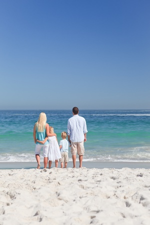 Portrait of a family on the beach photo