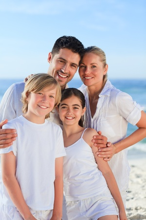 Portrait of a cute family at the beach photo