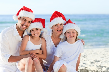 Family during Christmas day at the beach photo