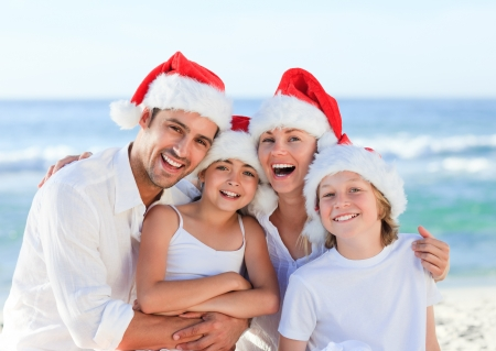 guy on beach: Family during Christmas day at the beach Stock Photo
