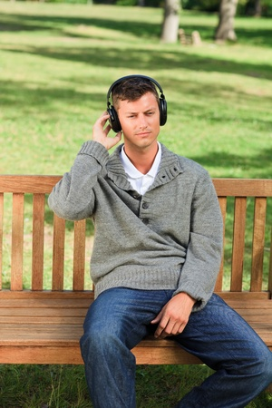Relaxed man listening to some music  photo