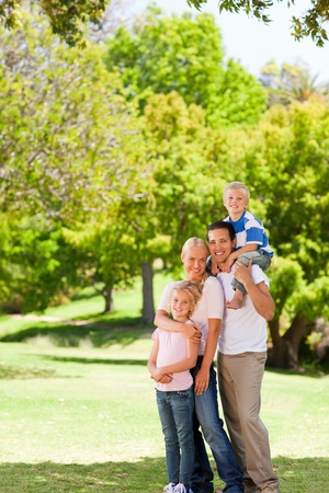 Happy family in the park photo