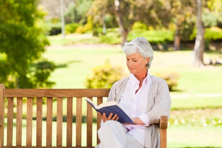 Retired woman reading a book photo