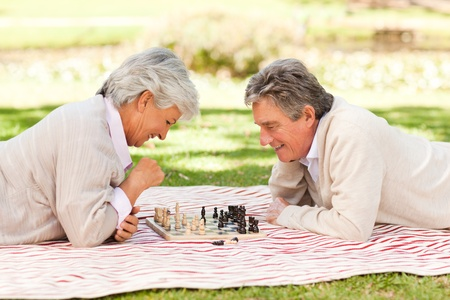 Elderly couple playing chess photo