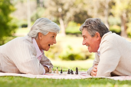 Retired couple playing chess photo