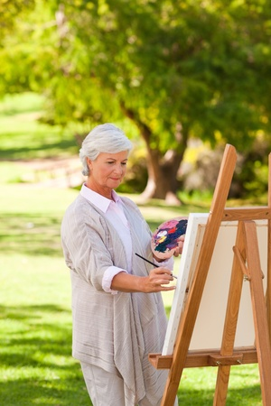 Senior woman painting in the park Stock Photo - 10174086
