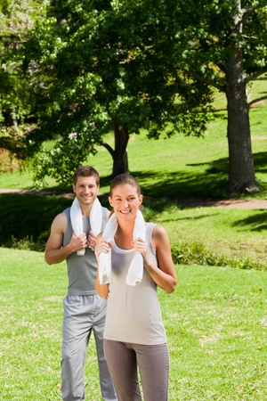 Exhausted couple in the park Stock Photo - 10220695