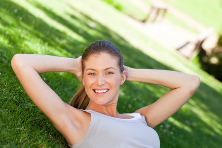 Woman doing her stretches in the park Stock Photo - 10173738