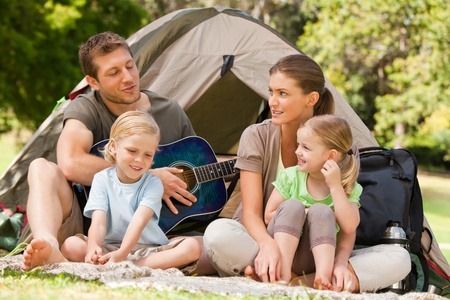 Family camping in the park photo