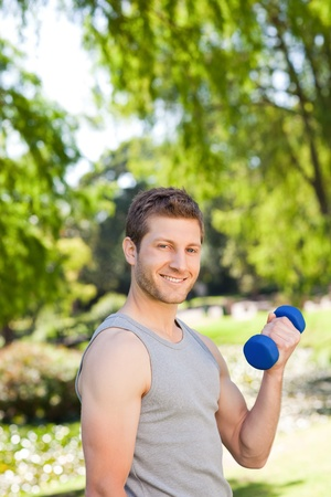 Young man doing his exercises in the park photo