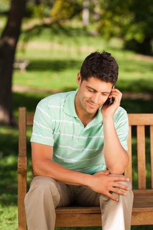 Young handsome man phoning  photo