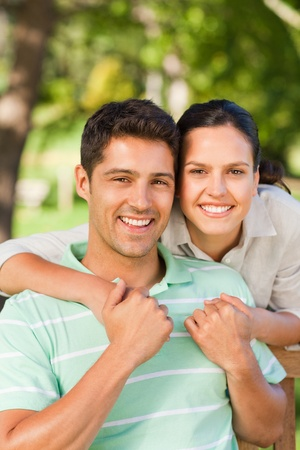 Woman huging her boyfriend photo