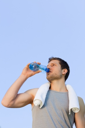 Man drinking water after the gym photo
