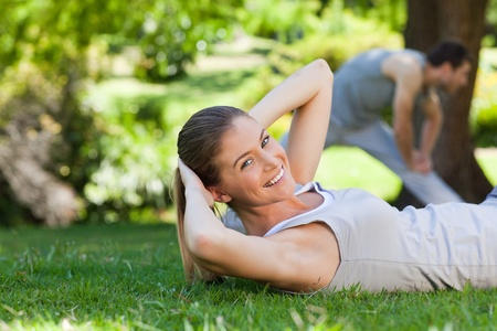 Couple doing their stretches in the park photo