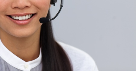 Close-up of a businesswoman using headset photo