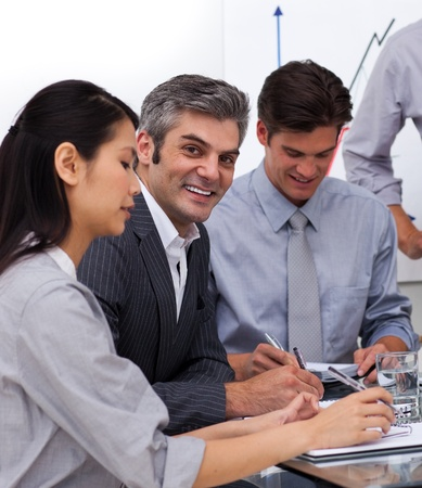 Multi-ethnic business co-workers in a meeting Stock Photo - 10216082