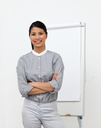 Self-assured asian businesswoman with folded arms