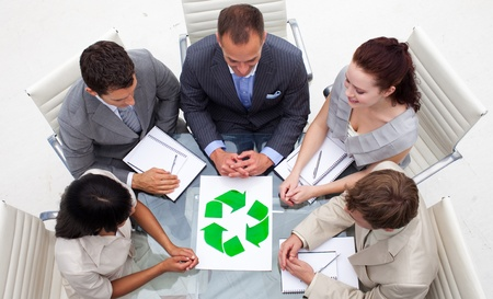 High angle of business team looking at a recycling symbol Stock Photo - 10219114