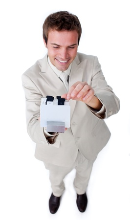directory book: Positive businessman holding a book at the camera