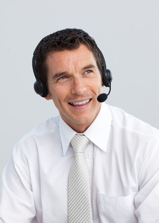 Smiling mature man working in a call center photo
