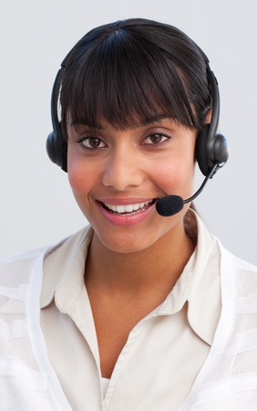 Beautiful ethnic businesswoman working in a call center photo