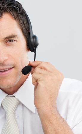 hotline: Close-up of an attractive businessman working in a call center Stock Photo