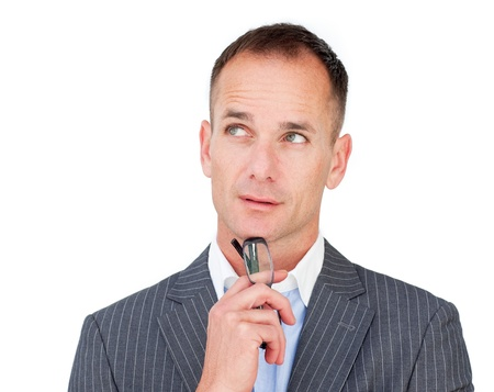 Pensive mature businessman holding glasses  photo