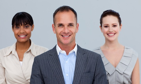 Smiling businessman leading his colleagues photo