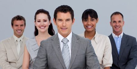 Positive multi-ethnic business team in front of the camera photo