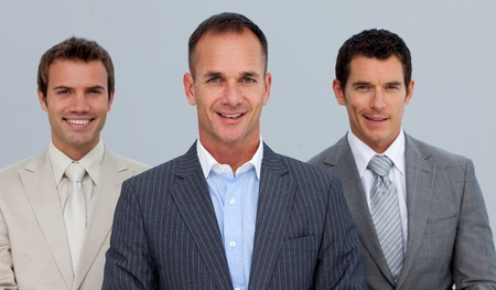 Portrait of smiling businessmen with folded arms photo
