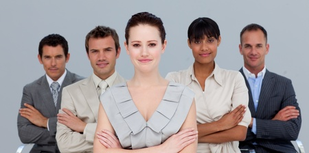 Confident multi-ethnic business team with folded arms photo